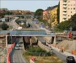 stockholmgrune-linien/2253/blick-vom-bereich-friedhemsplan-auf-die Blick vom Bereich Friedhemsplan auf die Strecke in Richtung Westen. Im Hintergrund ist die Station Thorildsplan zu erkennen. Im Vordergrund sieht man die Tunnelrampe zum Tunnel unter Kungsholmen. 29.08.2007 (Matthias)